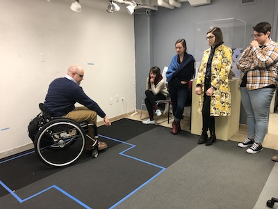 Students learn from experience designer Ben Baker about accessibility in museums.