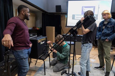 Students learn how to set up mics during Advanced Mic Tech class.