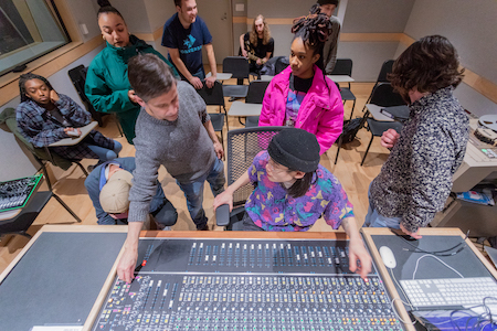 Brian McTear shows students the mixing board during Analog Recording class.