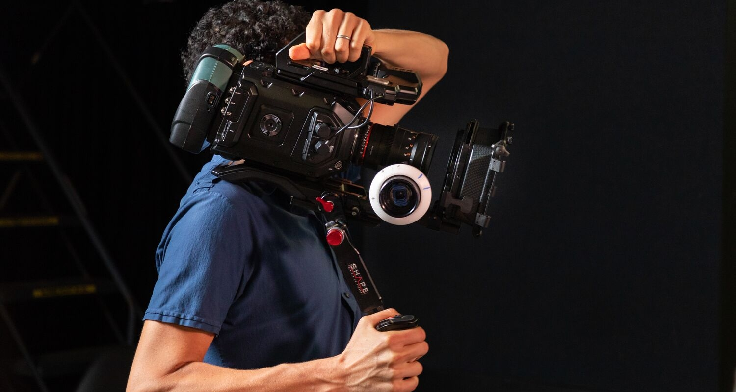 UArts student holding an advanced camera
