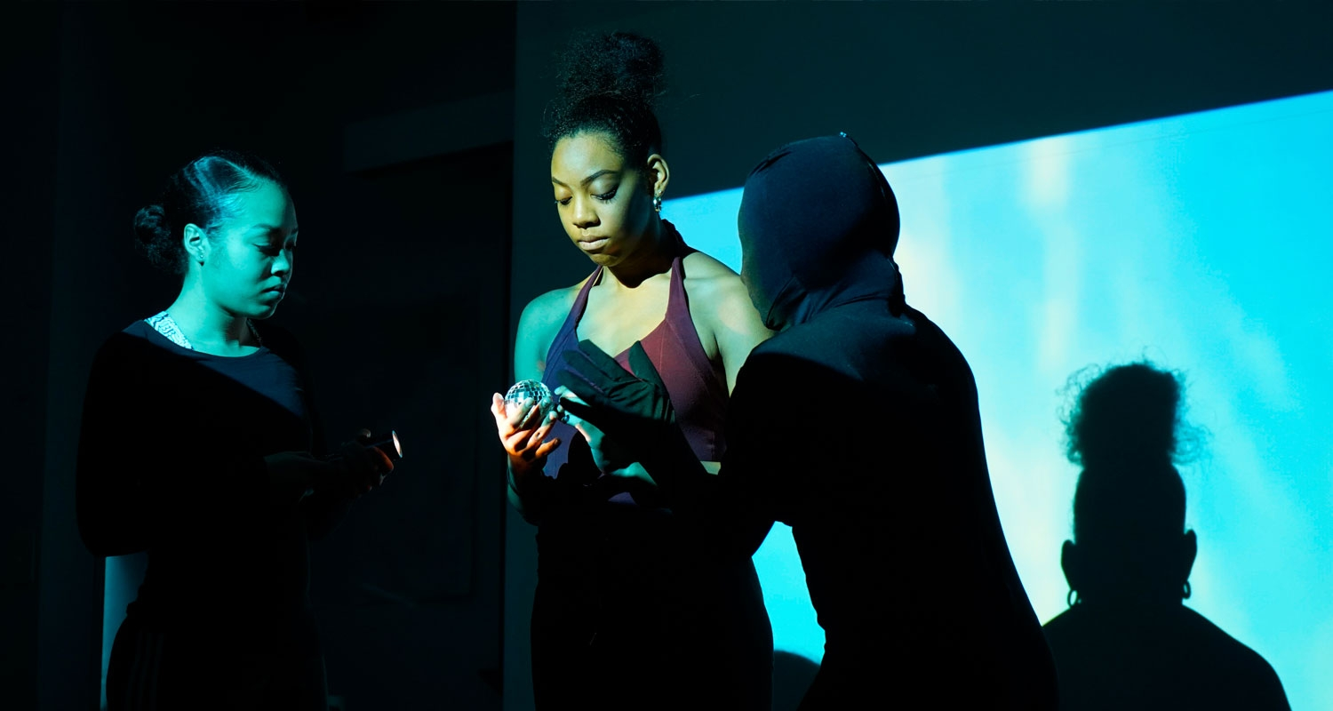 UArts students perform during an annual show against a blue screen set
