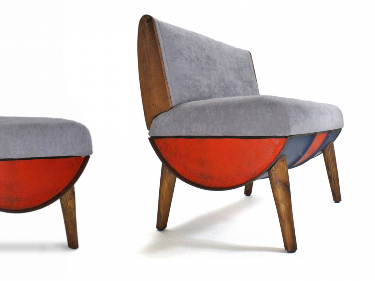 Two grey couches with oil drums as the bottom and wood as the legs