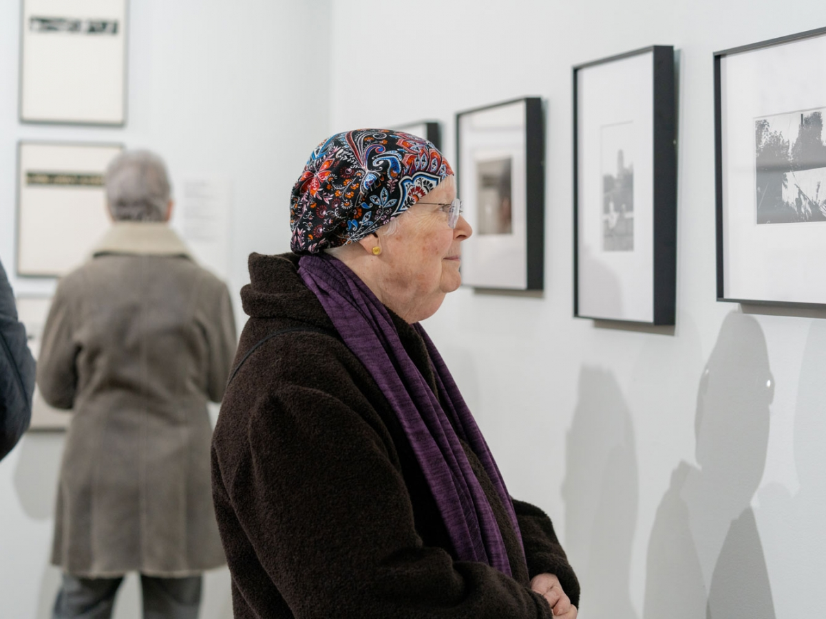 A person looking at a photograph in the Invisible City gallery