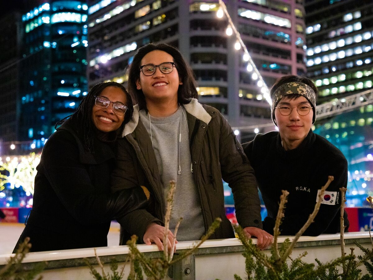 Students pose for a picture while ice skating at Dilworth Park