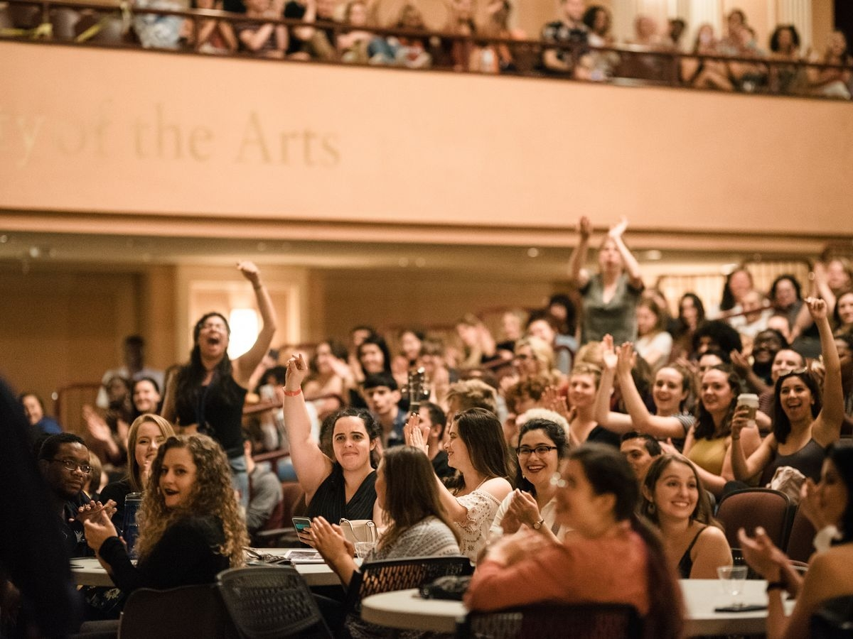 Students cheer during New Student Orientation