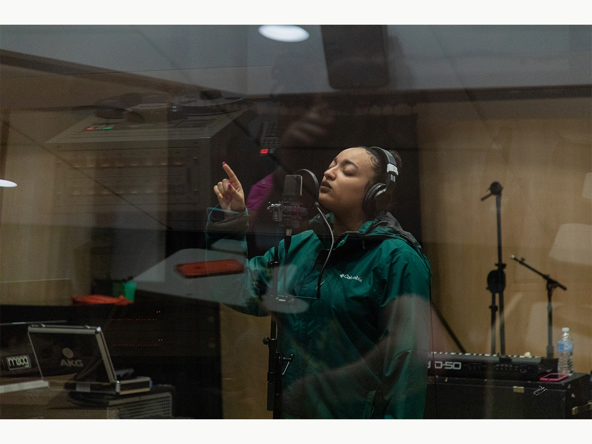A student records vocals in the Laurie Wagman Recording Studios