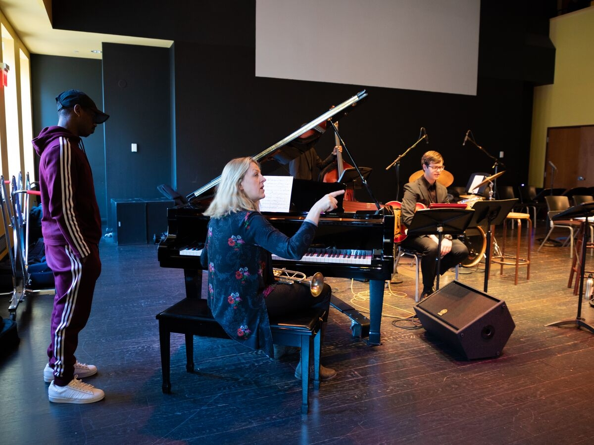 Ingrid Jensen speaks with students during her masterclass.