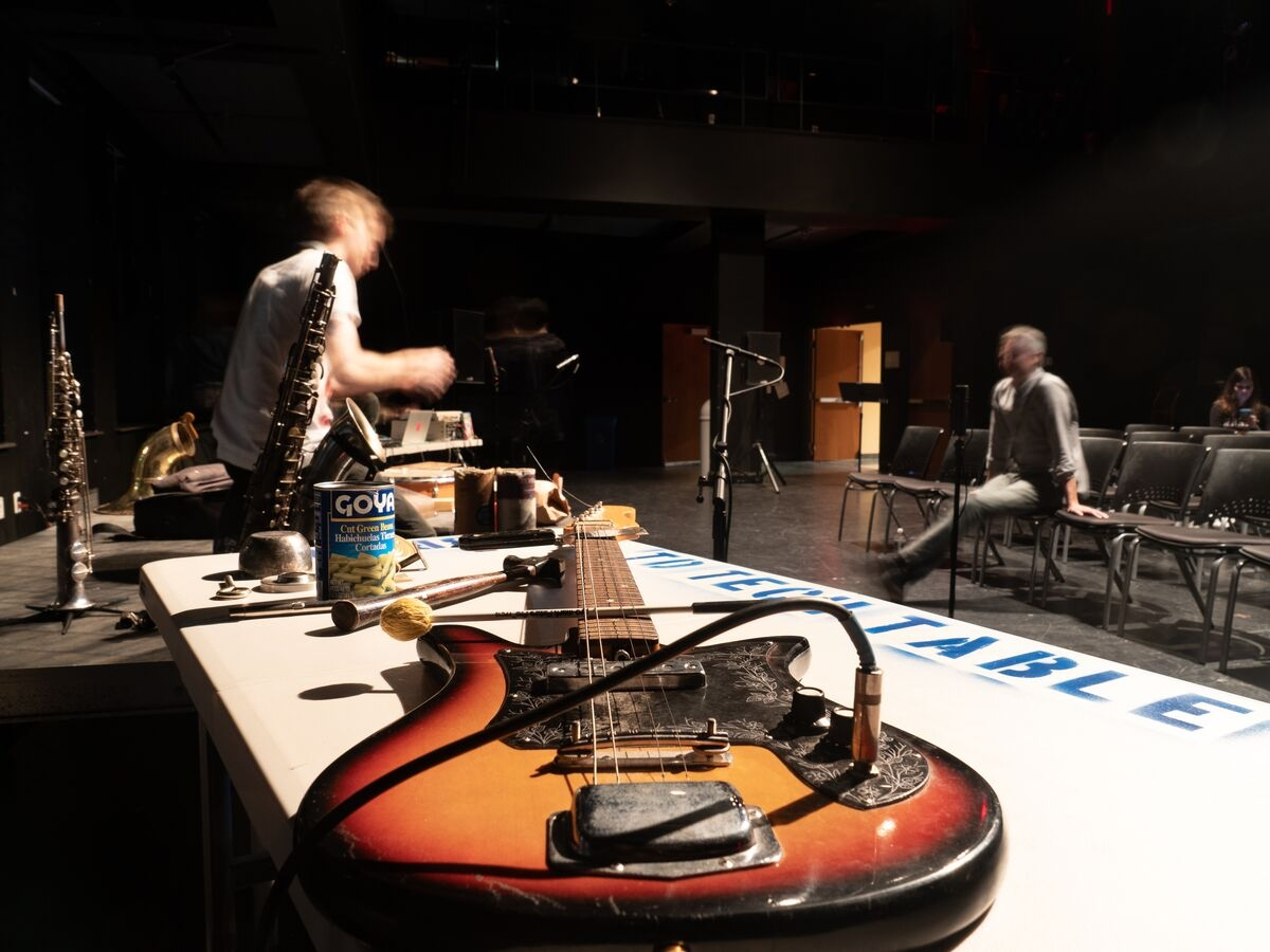 Students set up instruments and gear for the Out of the Box performance.