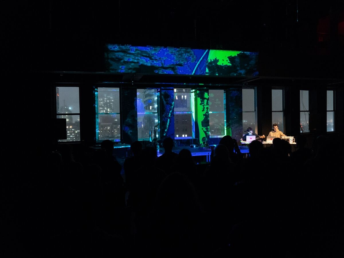Students perform with visuals during the Out of the Box concert.