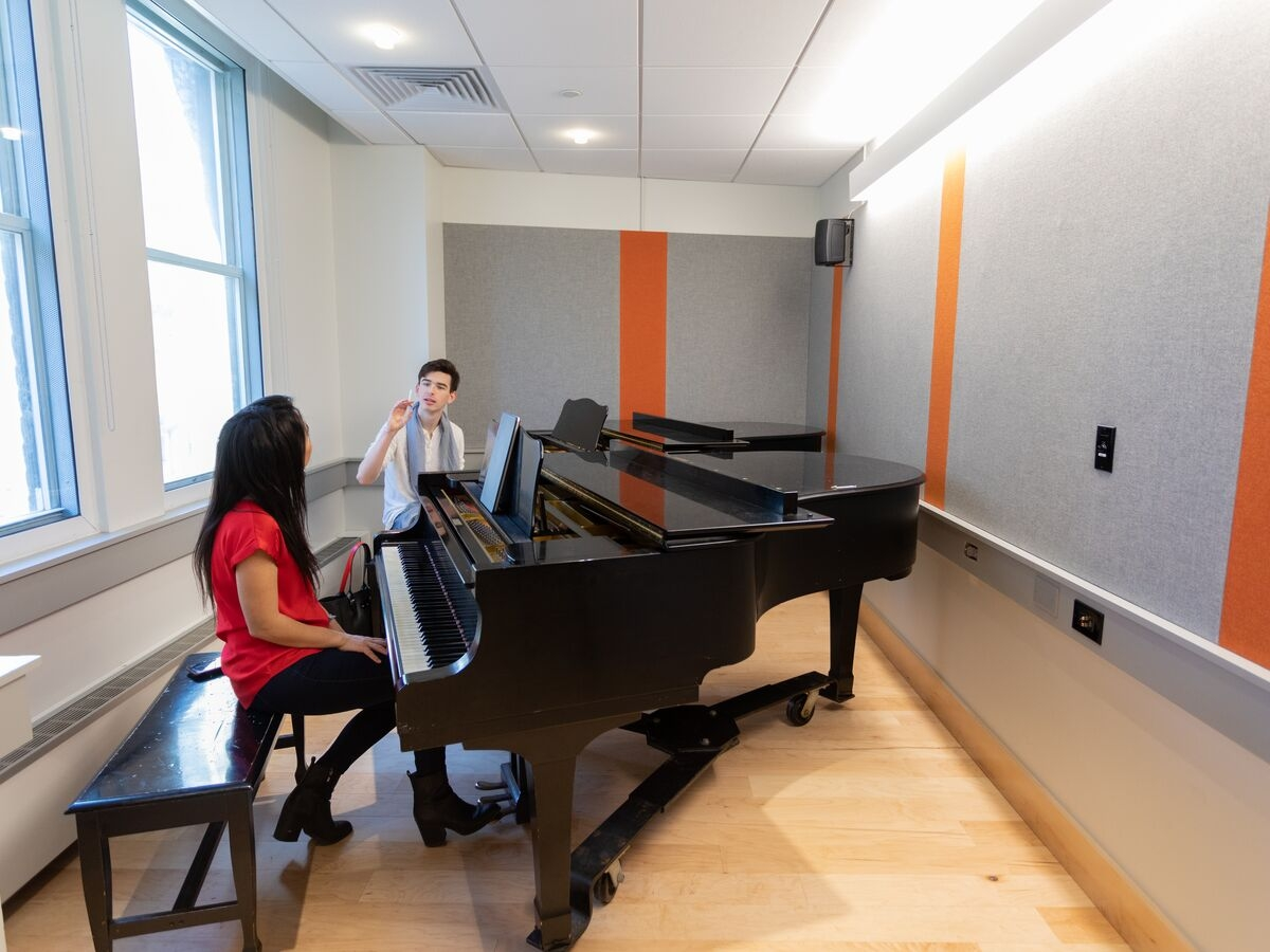A student takes a private piano lesson with faculty member AJ Luca.