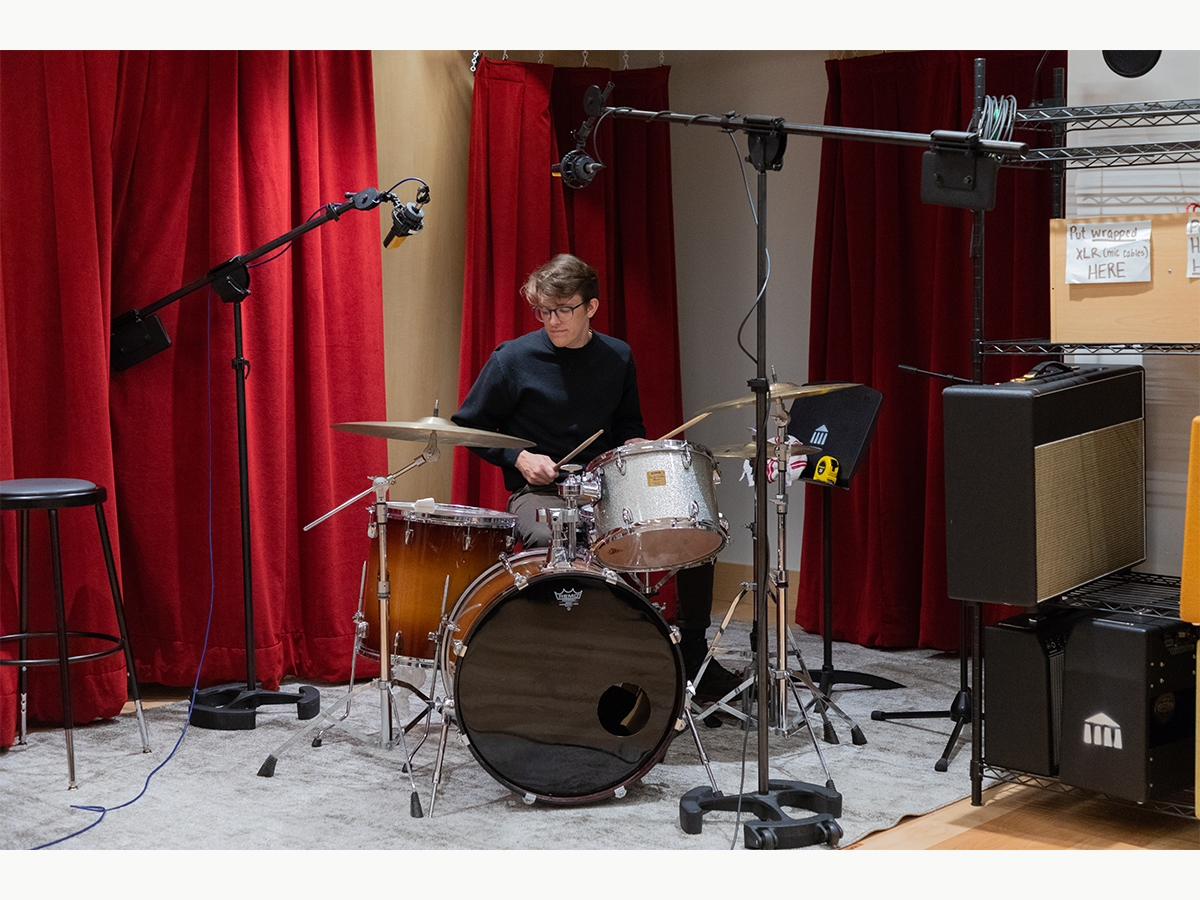 A drummer records during a recording session