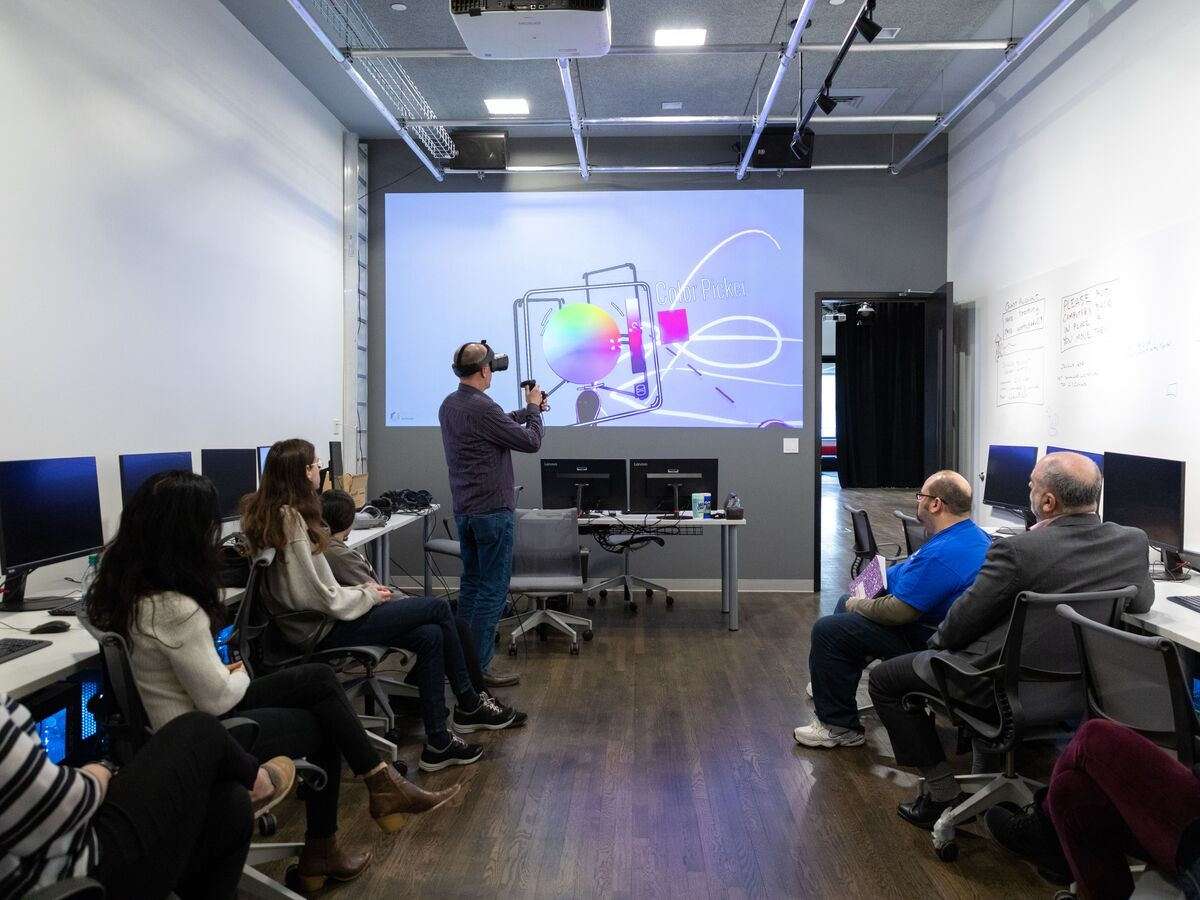Alan Price presents a demo of Virtual Reality hardware and software to School of Design faculty and staff.
