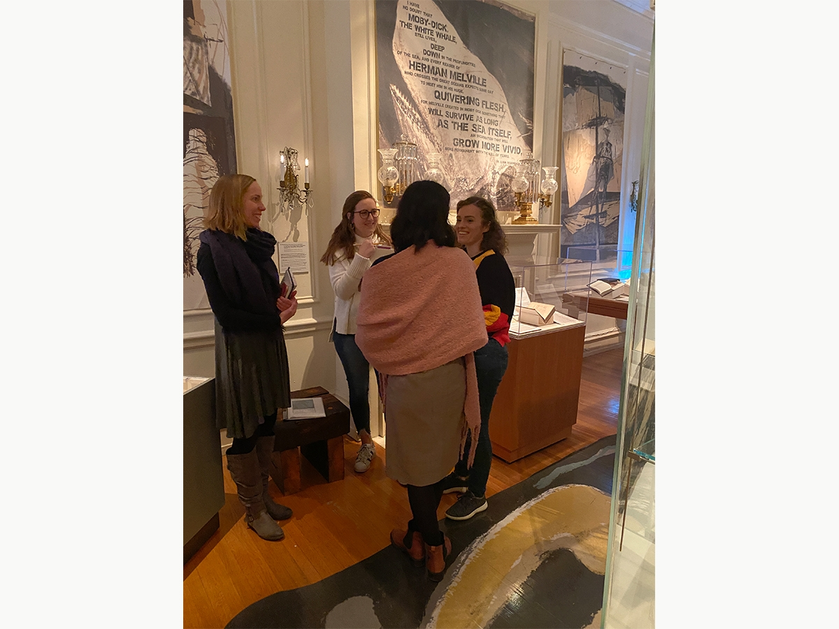 Students explore an exhibit at The Rosenbach with a tour guide.