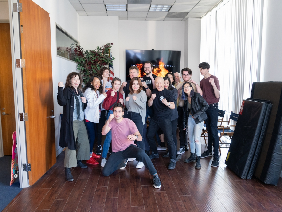 Students and faculty pose for a picture with professional stuntmen during their visit to the Stuntmen's Association of Motion Pictures | Stuntwomen's Association of Motion Pictures.