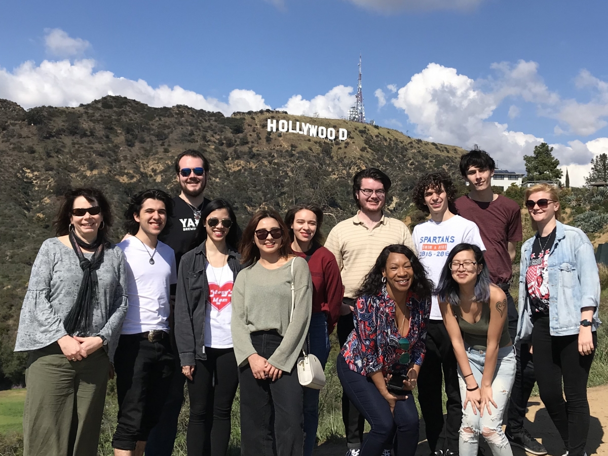 Students and faculty pose for a picture in front of the Hollywood sign during their trip to Los Angeles, CA.