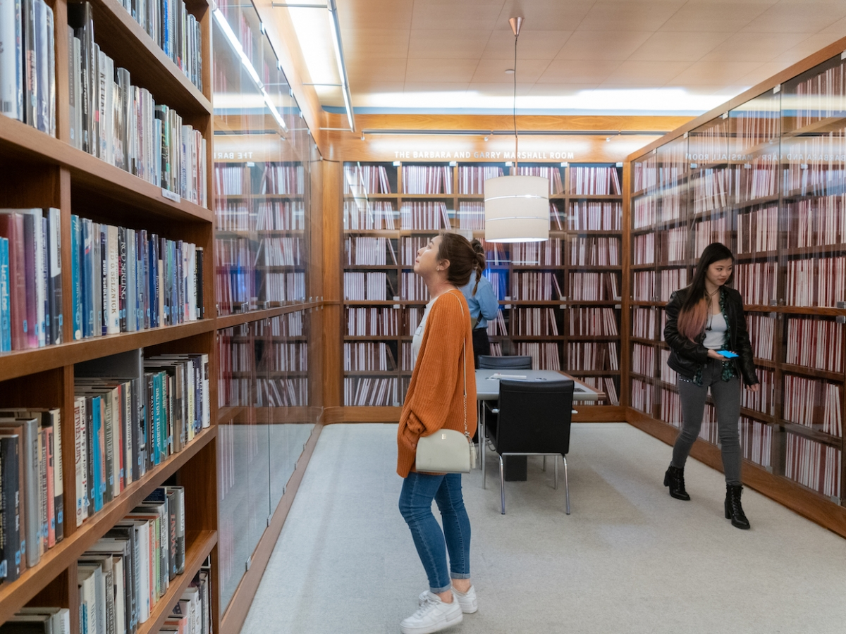 A student browses the library of the Writers Guild of America West in Los Angeles, CA.