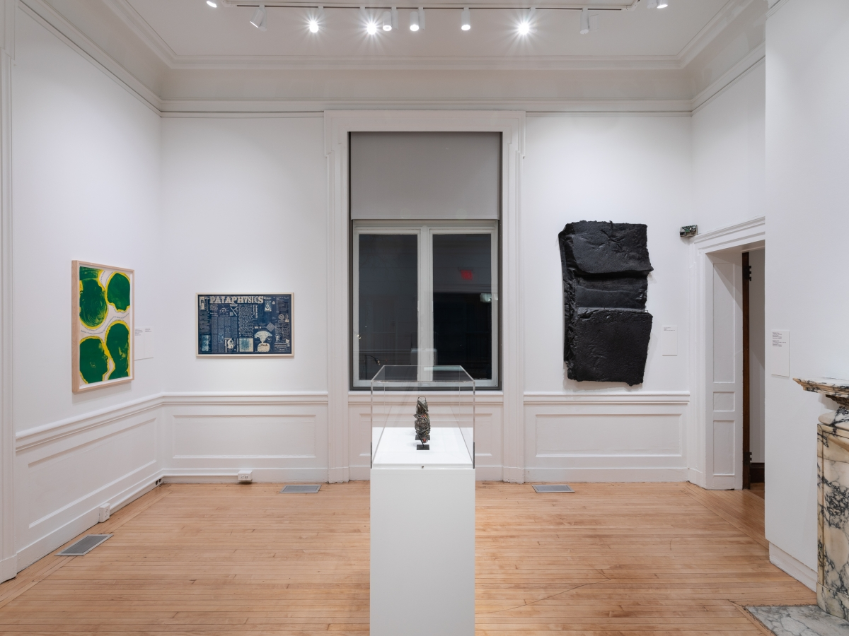 Invisible City exhibition, Gallery A; three works on the wall and one in a case in the center of the room