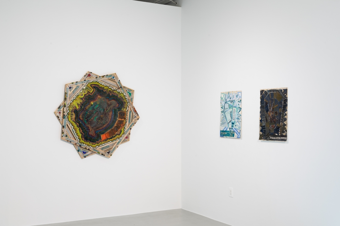 Two of Mike Cloud's painting hang on the gallery of Rosenwald-Wolf Gallery