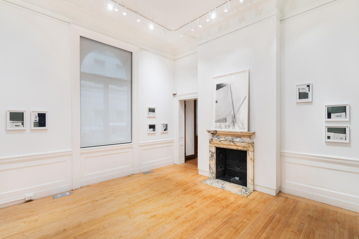 Installation shot of Nyeema Morgan's smaller framed collages hanging on white walls throughout a gallery space with white walls, wooden floor and a large window on the left wall. A larger framed graphite drawing hangs above a prominent marble fireplace right of center and the collages continue on the right wall.