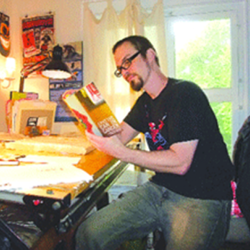 Christian Patchell at his drawing table
