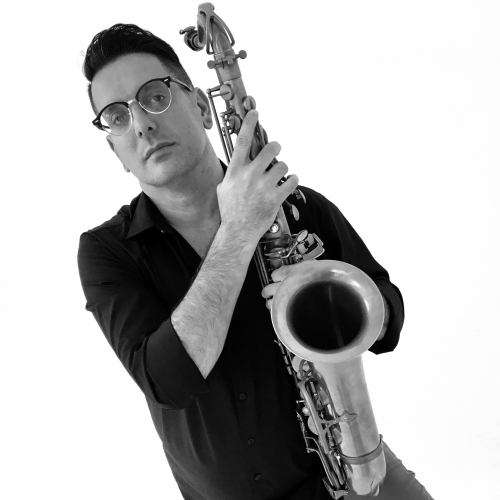 A black-and-white, slanted image of Chris Farr holding a sax.