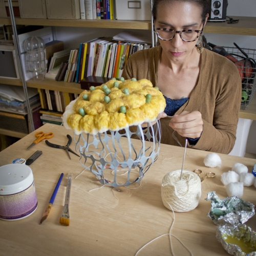 Joy Dilworth creating yellow and green fibers piece at table