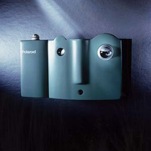 A light blue Mugshot Polaroid camera.