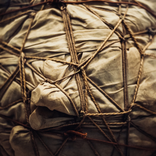 An image of a package wrapped in brown paper and string - one of the artist Christo's works