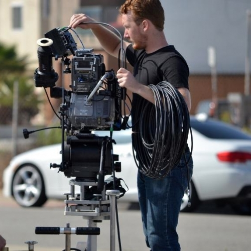 Andrew Wheeler adjusting film camera on location