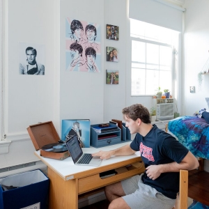 Student at Spruce Residence Hall desk
