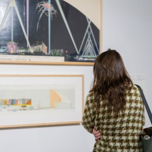 A person looking at a painting in the Invisible City gallery