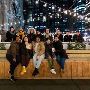 Students pose for a picture during an ice skating night at Dilworth Park
