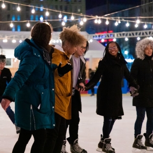 Students ice skate in Dilworth Park