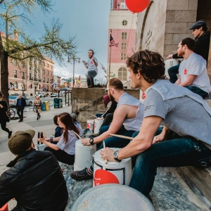 Bucket Drumming ensemble performs on the steps of Hamilton Hall.