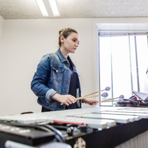 A student practices vibraphone.