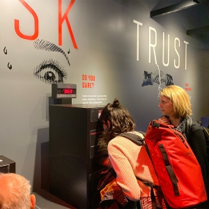 Faculty member Stephanie Reyer and a student look at an interactive exhibit at the International Spy Museum.