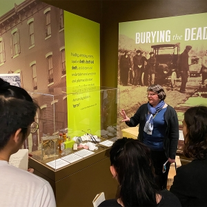 "Students look at the exhibit ""Burying the Dead"" with a tour guide at the Mutter Museum."