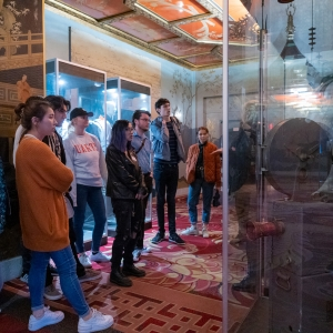 Students gather around an exhibit in the TCL Chinese Theatre during their trip to Los Angeles, CA.